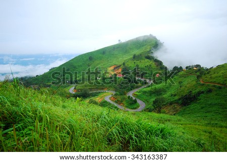 Mountain view with crooked road - stock photo