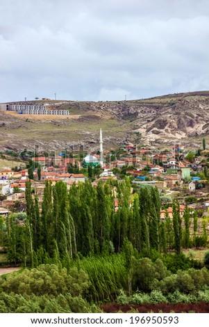 Mountain village landscape, Cavusin, Cappadocia green tour, Turkey   - stock photo