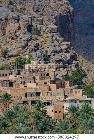 Mountain village of Misfat Al Abriyeen, perched on the steep walls of a deep canyon, Sultanate of Oman - stock photo