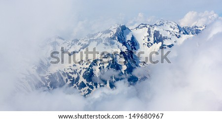 Mountain vista in the clouds - stock photo