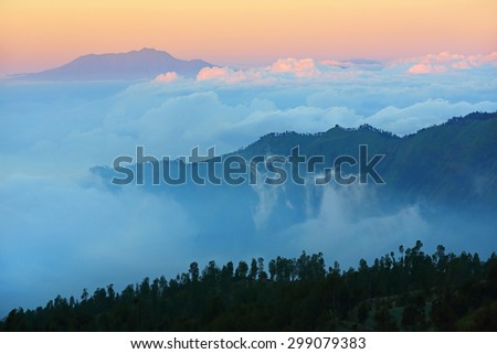 Mountain with beautiful mist at sunset, Mount Bromo of East Java, Indonesia - stock photo