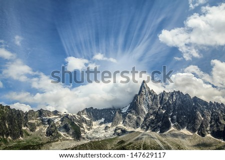 Mountain with clouds. French alps - stock photo