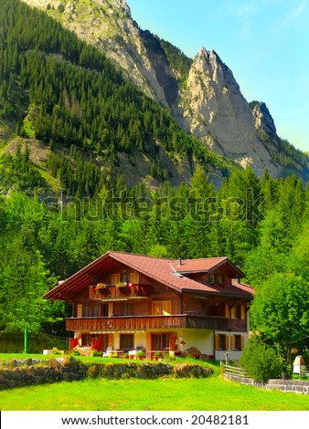 Mountain wooden house in Swiss Alps - stock photo