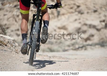 Mountainbike.Mountain bike sport athlete man riding outdoors - stock photo