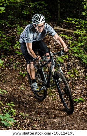 Mountainbiker in a downhill - stock photo