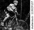mountainbiker with splashing water - stock photo