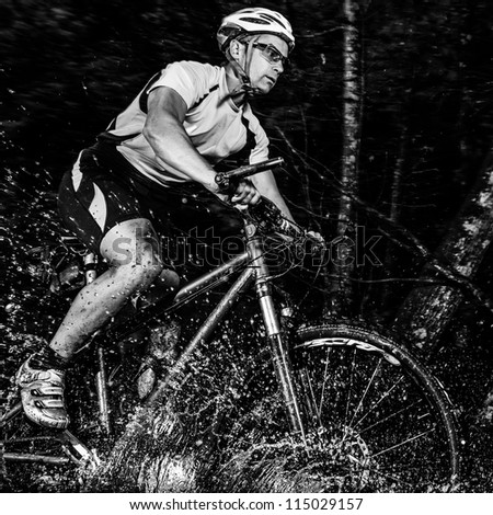 mountainbiker with splashing water - stock photo