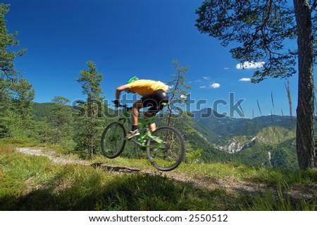 Mountainbikers jump - stock photo