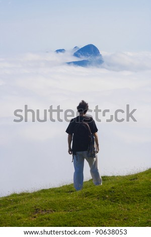 Mountaineer and sea of clouds, Harria Aiako Natural Park, Oiartzun, Gipuzkoa - stock photo