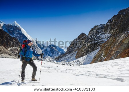 Mountaineer sport. A climber with sticks on the glacier trail   - stock photo