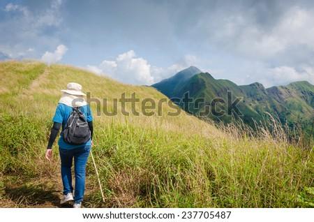 Mountaineer tourists hiking on (Khao Chang Puak) of mountains at Kanchanaburi, Thailand. - stock photo