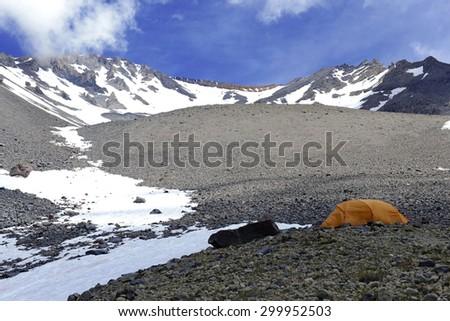 Mountaineering Tent in Alpine landscape on Mount Shasta in the Cascade Range, California, USA - stock photo