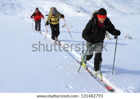Mountaineers climbing with skies on the mountain - stock photo