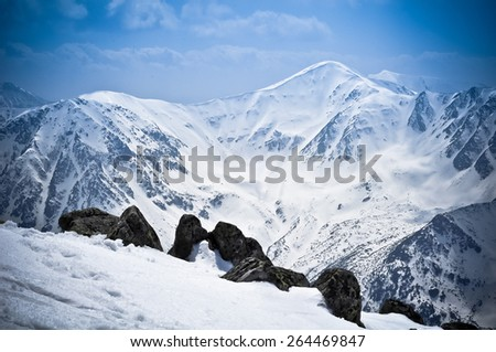 Mountains and rocks in winter season. - stock photo
