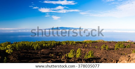 Mountains beautiful inspirational landscape view, islands and ocean, Canary Islands La Gomera island view from Tenerife island. - stock photo