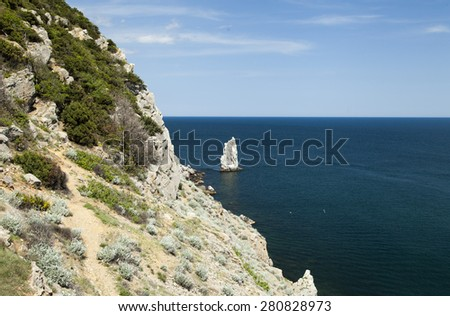 Mountains by the sea in beams of a bright sun - stock photo
