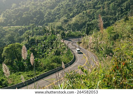 Mountains car travel in summer landscape  - stock photo