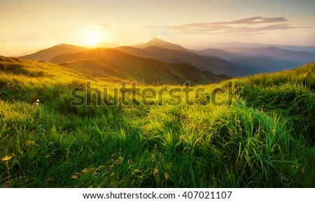 Mountains during sunset. Beautiful natural landscape in the summer time - stock photo