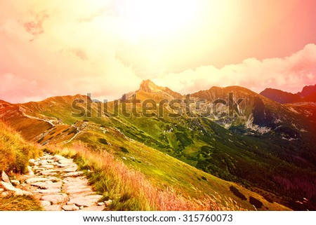 Mountains. Fantasy and colorful nature landscape. Nature conceptual image. Sunset over mountains. - stock photo