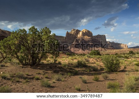 Mountains in the San Rafael Swell lit by the setting sun near Green River and Emery Utah photographed at Reds Canyon. - stock photo