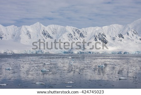 Mountains of Antarctic peninsula in summer time - stock photo