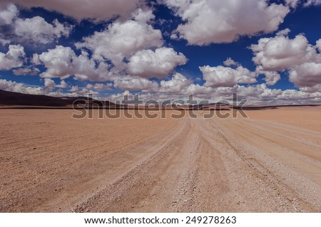 Mountains of Bolivia, altiplano, desert and green landscapes, trees and rocks, sand and water, sky and earth. Beautiful views of South America - stock photo