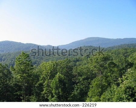 Mountains on a sunny day - stock photo