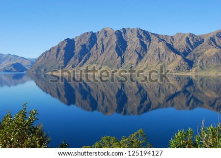 Mountains reflected in lake near Queenston, New Zealand - stock photo