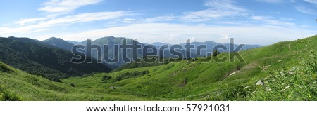 Mountains, rocks; a relief; a landscape; a hill; a panorama; Caucasus; top; a slope; clouds; the sky; a landscape - stock photo