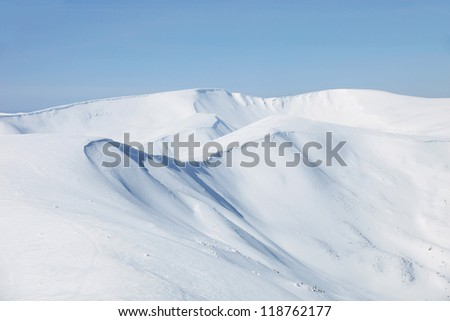 Mountains slopes covered with snow - stock photo
