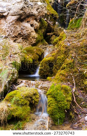Mountains stream with moss stones at forest in autumn. Cuervo river, Cuenca, Spain - stock photo