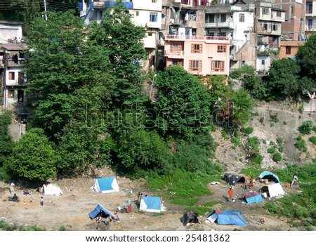 Mountainside dwelling at the base of the Himalayas, India - stock photo