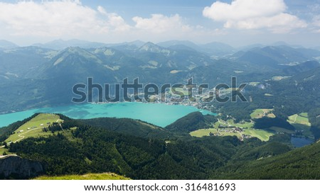 Mountaintop view over lake Wolfgangsee in Austria, as seen from the Schafberg mountaintop on a sunny summer day. - stock photo