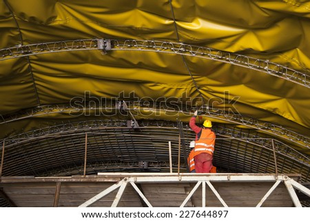 Mounting of insulation and steel framework on vault of tunnel on highway in Croatia - stock photo