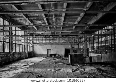 mounting workshop in an old factory, black and white - stock photo