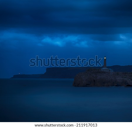 Mouro island lighthouse.Night shot.Cantabria,Spain. - stock photo