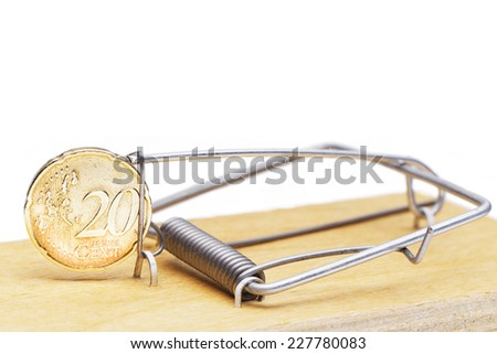 Mouse catcher with coin - stock photo
