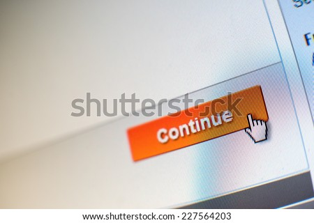 "Mouse Clicking ""Continue"" button for internet shopping in an e-commerce website - stock photo"
