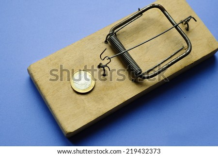 Mouse trap with Euro coin on white background - stock photo