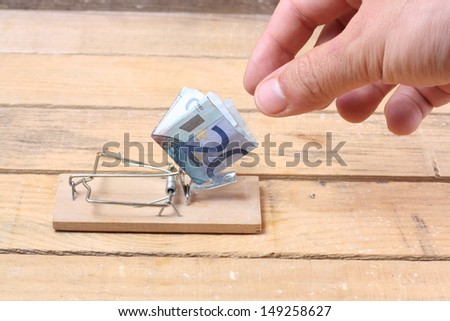 Mouse trap with money - stock photo