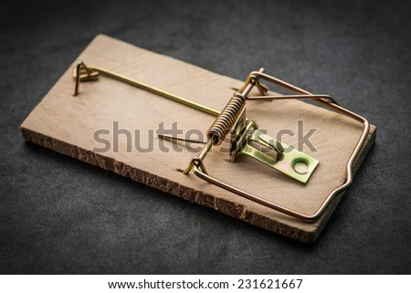Mousetrap on dark background. Selective focus. - stock photo