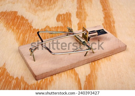 Mousetrap on the wooden table - stock photo
