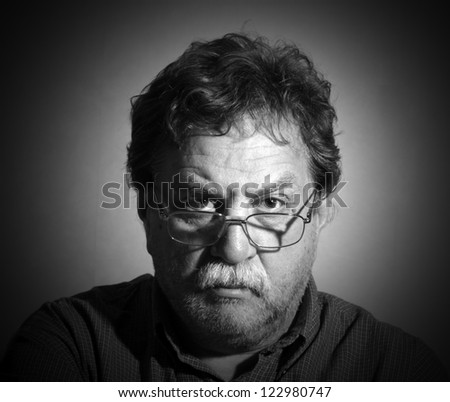 moustached unshaven middle-aged man with glasses - stock photo