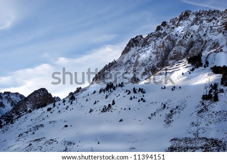 Moutain Peaks full of snow at Pyrenees - stock photo