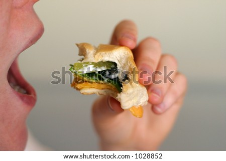 Mouth about to take bite - stock photo