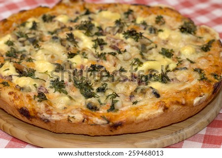 Mouthwatering homemade pizza with seafood, close-up - stock photo