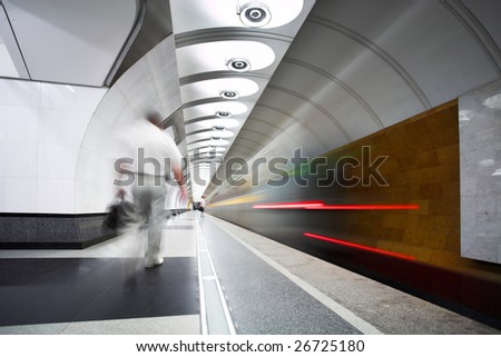 Move train on platform in subway and person run - stock photo