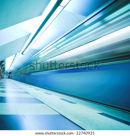 Move train on underground station - stock photo