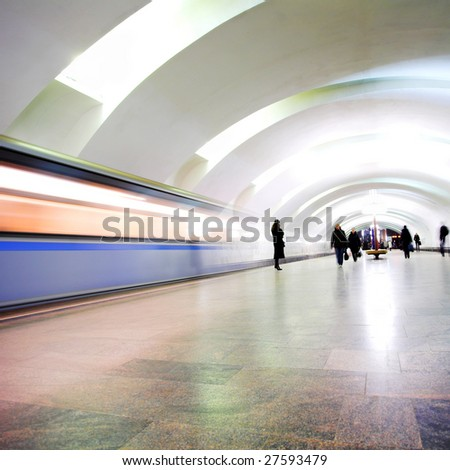 Move train on underground station and people silhouettes - stock photo
