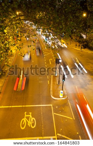 Movement Busy Traffic Road at Night, London, England  - stock photo